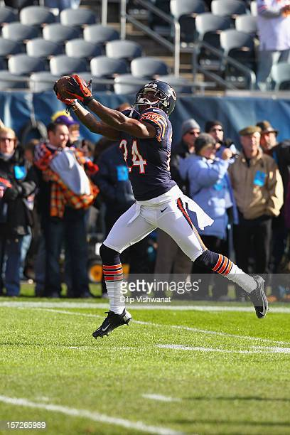 Kelvin Hayden of the Chicago Bears makes a catch during warm ups at Soldier Field on November 25 2012 in Chicago Illinois