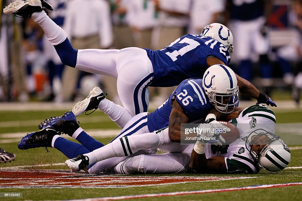 Kelvin Hayden #26 of the Indianapolis Colts tackles Braylon Edwards #17 of the New York Jets during the first quarter of the AFC Championship Game at Lucas Oil Stadium on January 24, 2010 in Indianapolis, Indiana.