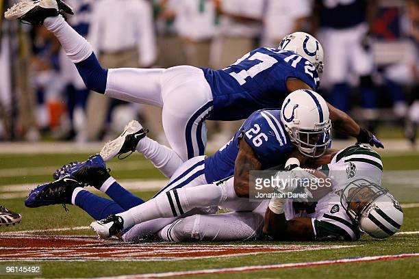 Kelvin Hayden of the Indianapolis Colts tackles Braylon Edwards of the New York Jets during the first quarter of the AFC Championship Game at Lucas...