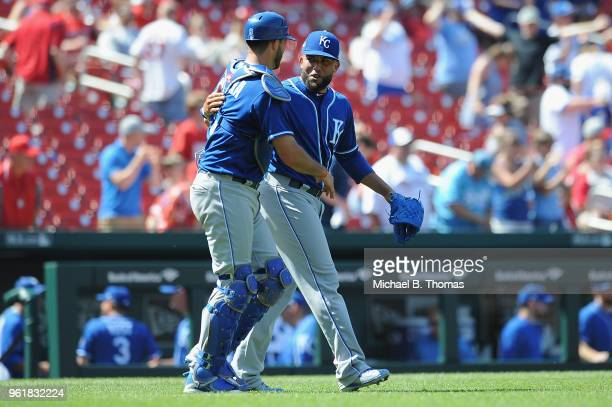 Kelvin Herrera and Drew Butera of the Kansas City Royals celebrate after defeating the the St Louis Cardinals 52 at Busch Stadium on May 23 2018 in...