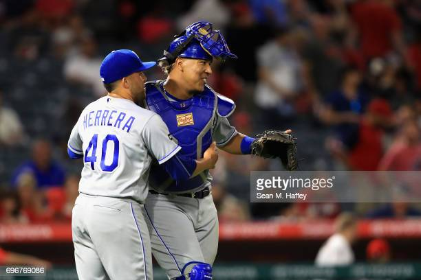 Kelvin Herrera and Salvador Perez of the Kansas City Royals celebrate defeating the Los Angeles Angels of Anaheim 21 in a game at Angel Stadium of...