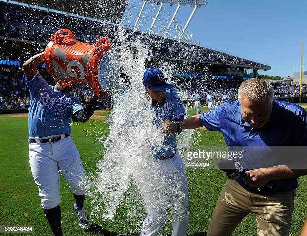 Kelvin Herrera of the Kansas City Royals and Fox Sports Kansas City announcer Joel Goldberg are doused with water by Salvador Perez of the Kansas...