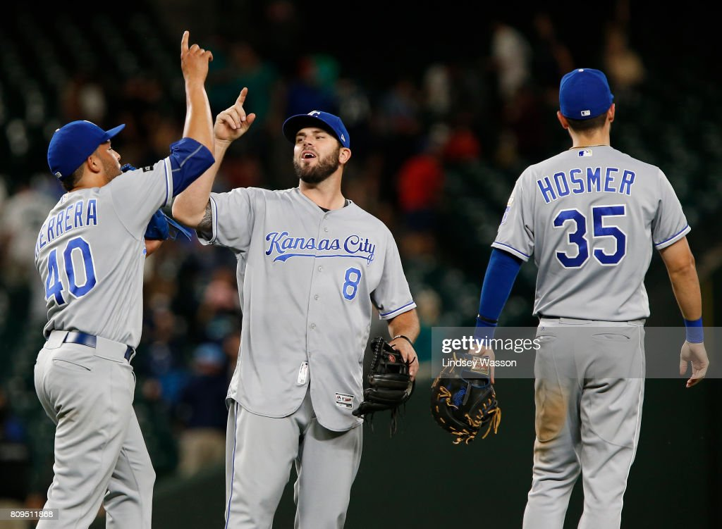 Kelvin Herrera #40 of the Kansas City Royals celebrates their win against the Seattle Mariners with Mike Moustakas #8 and Eric Hosmer #35 at Safeco Field on July 5, 2017 in Seattle, Washington.