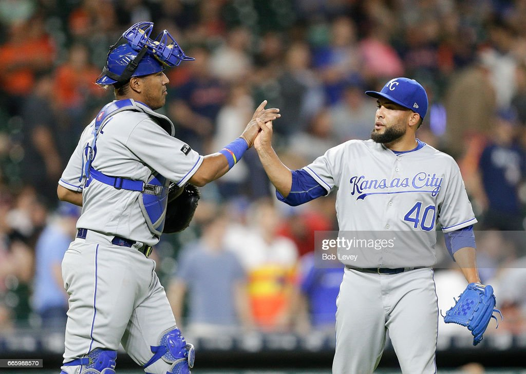 Kelvin Herrera #40 of the Kansas City Royals high fives Salvador Perez #13 after the final out after winning 5-1 over the Houston Astros at Minute Maid Park on April 7, 2017 in Houston, Texas.