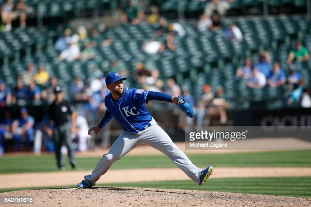 Kelvin Herrera of the Kansas City Royals pitches during the game against the Oakland Athletics at the Oakland Alameda Coliseum on August 16 2017 in...