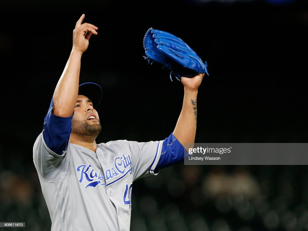 Kelvin Herrera #40 of the Kansas City Royals points to the sky as Robinson Cano #22 of the Seattle Mariners grounds out in the tenth inning to win the game at Safeco Field on July 5, 2017 in Seattle, Washington.