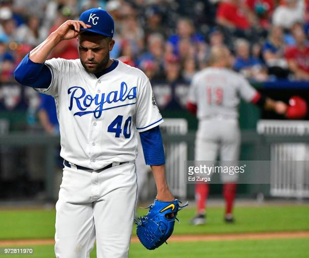 Kelvin Herrera of the Kansas City Royals walks off the field after throwing in the ninth inning against the Cincinnati Reds at Kauffman Stadium on...