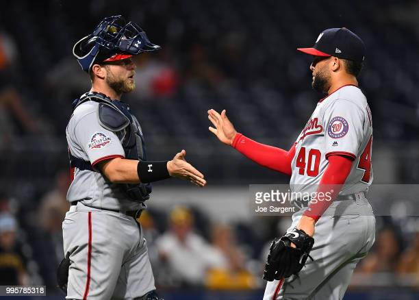 Kelvin Herrera of the Washington Nationals celebrates with Spencer Kieboom after a 51 win over the Pittsburgh Pirates at PNC Park on July 10 2018 in...