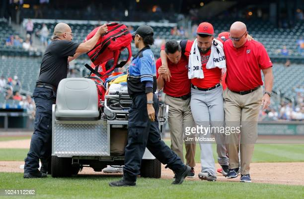 Kelvin Herrera of the Washington Nationals is helped off the field after an injury during the ninth inning against the New York Mets at Citi Field on...