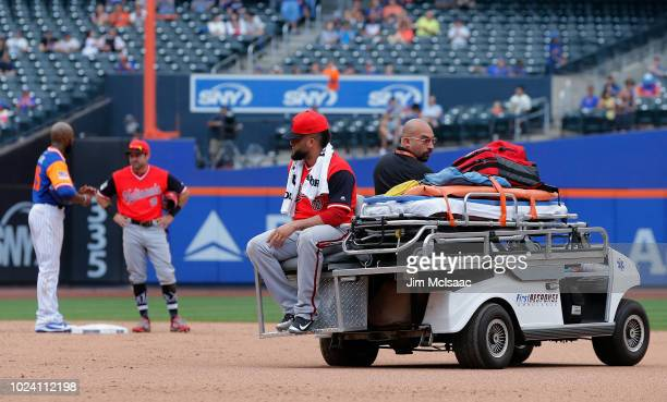 Kelvin Herrera of the Washington Nationals is taken off the field after an injury during the ninth inning against the New York Mets at Citi Field on...