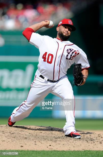 Kelvin Herrera of the Washington Nationals pitches in the ninth inning against the Cincinnati Reds at Nationals Park on August 5 2018 in Washington DC