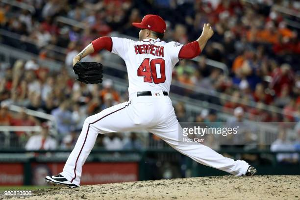 Kelvin Herrera of the Washington Nationals throws to a Baltimore Orioles batter in the eighth inning against the Baltimore Orioles at Nationals Park...