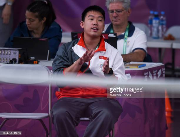 Kelvin Ho Mulyo Handoyo coach of Yue Yann Jaslyn Hooi of Singapore gestures during a match against Tereza Svabikova of Czech Republic on day 1 of the...