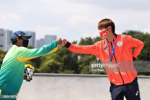 Kelvin Hoefler of Team Brazil, winner of silver medal, and Yuto Horigome of Team Japan, winner of the gold medal, bump fists at the Skateboarding...