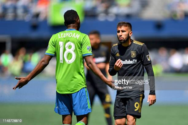 Kelvin Leerdam of Seattle Sounders and Diego Rossi of Los Angeles FC try to find common ground during the match at CenturyLink Field on April 28 2019...