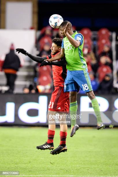 Kelvin Leerdam of Seattle Sounders FC and Jonathan Osorio of Toronto FC jump for the ball during the 2017 MLS Cup Final between Toronto FC and...