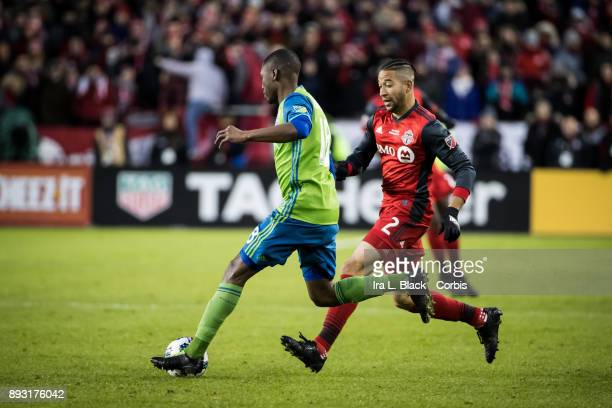 Kelvin Leerdam of Seattle Sounders tries to clear the ball from Justin Morrow of Toronto FC during the 2017 Audi MLS Championship Cup match between...