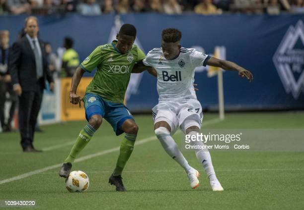 Kelvin Leerdam of the Seattle Sounders and Alphonso Davies of the Vancouver Whitecaps at BC Place on September 15 2018 in Vancouver Canada