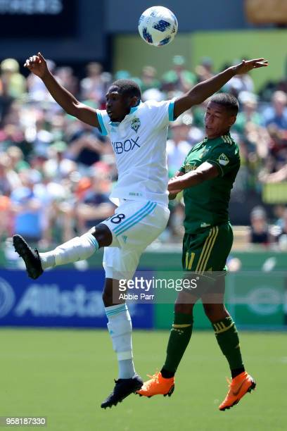 Kelvin Leerdam of the Seattle Sounders jumps for the ball against Andy Polo of the Portland Timbers in the first half during their game at Providence...