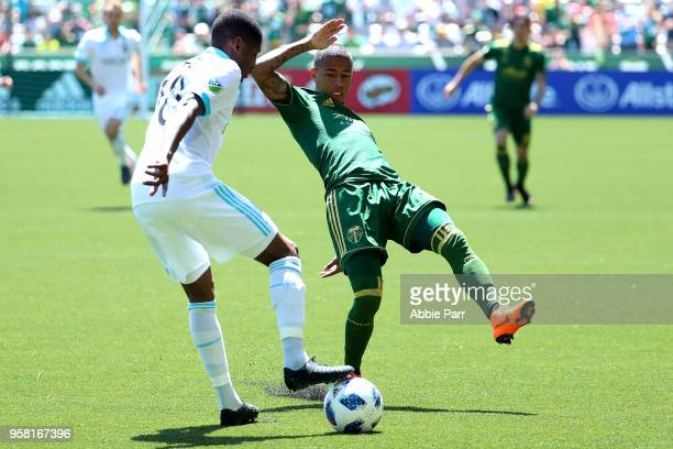 Kelvin Leerdam of the Seattle Sounders works against Andy Polo of the Portland Timbers in the first half during their game at Providence Park on May...