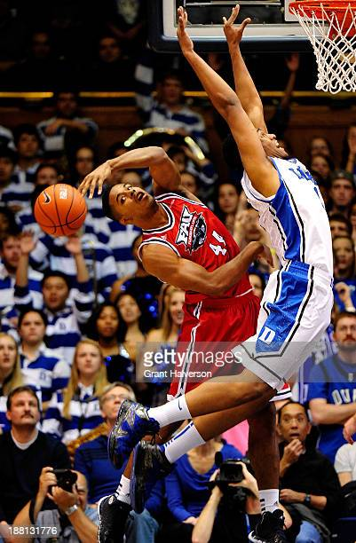 Kelvin Penn of the Florida Atlantic Owls slaps a rebound away from Jabari Parker of the Duke Blue Devils during play at Cameron Indoor Stadium on...