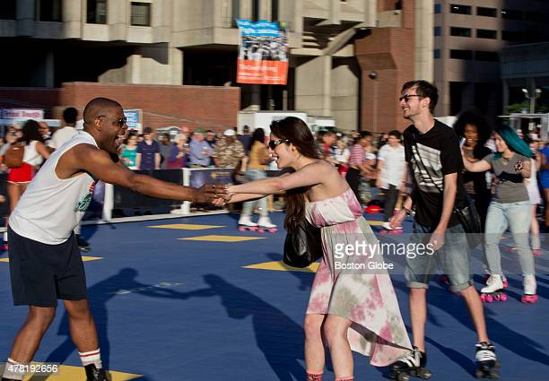 Kelvin Powell skate dancing with Parissa Salimian who he met on the rink floor during the Donna Summer Memorial Roller Disco on City Hall Plaza on...