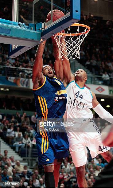 Kelvin Rivers #11 of BC Khimki Moscow Region competes with Marcus Slaughter #44 of Real Madrid during the 20122013 Turkish Airlines Euroleague...
