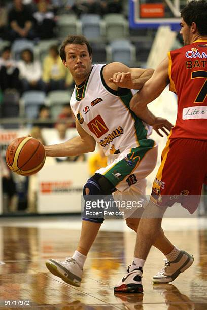 Kelvin Robertson of the Crocodiles looks to pass the basketball during the round three NBL match between the Melbourne Tigers and the Townsville...