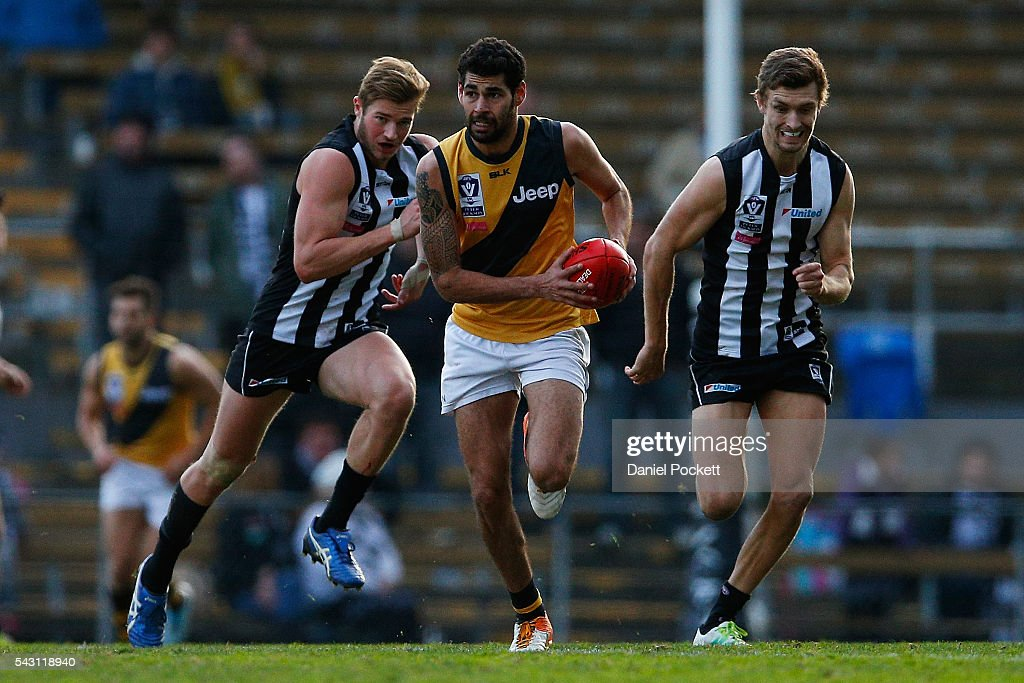Kelvin Williams of the Tigers runs with the ball during the round 12 VFL match between the Collingwood Magpies and the Richmond Tigers at Victoria Park on June 26, 2016 in Melbourne, Australia.