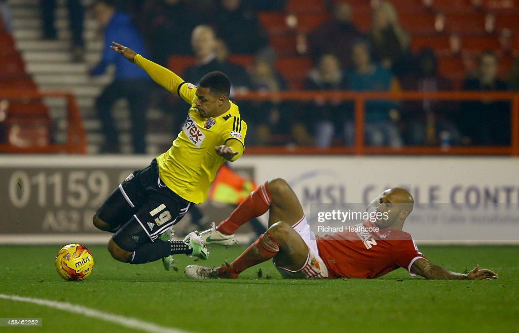 Kelvin Wilson of Forest brings down Andre Gray of Brentford to conceed a penalty during the Sky Bet Championship match between Nottingham Forest and Brentford at the City Ground on November 5, 2014 in Nottingham, England.
