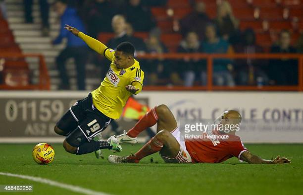 Kelvin Wilson of Forest brings down Andre Gray of Brentford to conceed a penalty during the Sky Bet Championship match between Nottingham Forest and...