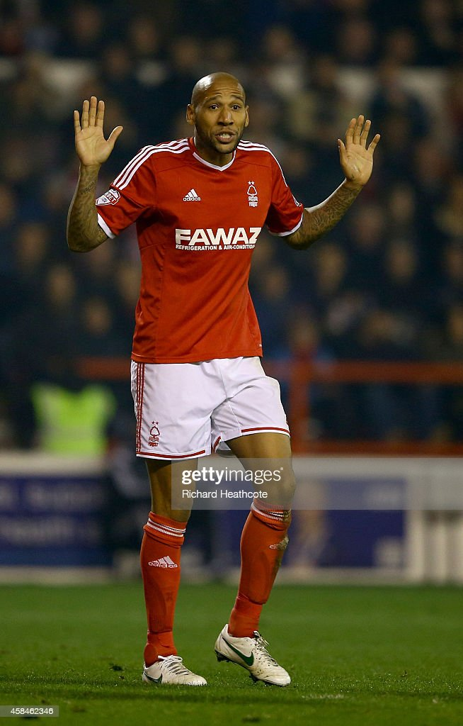 Kelvin Wilson of Forest pleeds his innocence after bringing down Andre Gray of Brentford to conceed a penalty during the Sky Bet Championship match between Nottingham Forest and Brentford at the City Ground on November 5, 2014 in Nottingham, England.