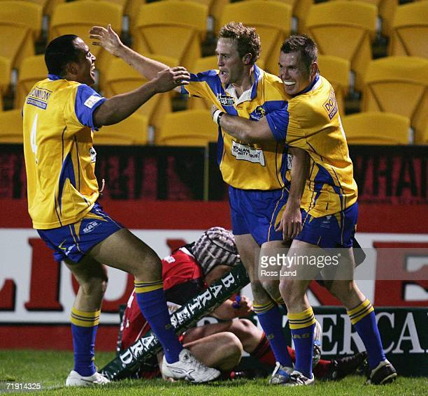 Kelvin Wright of the Lions celebrates his try with team mates Anthony Swann and Rowan Baxter during the NZRL National Premiership Bartercard Cup...