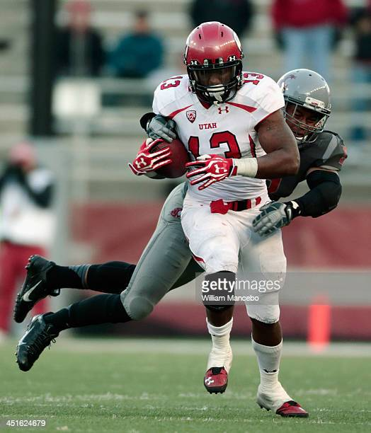 Kelvin York of the Utah Utes caries the ball against Darryl Monroe of the Washington State Cougars during the game at Martin Stadium on November 23...