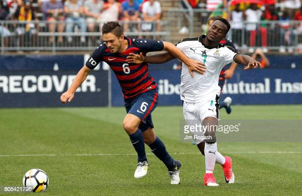 Kelyn Rowe of the United States battles battles David Accam of Ghana in the first half during an international friendly between USA and Ghana at...