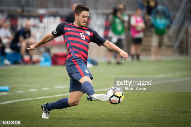 Kelyn Rowe of US Mens National Team tries to keep possession of the the ball during the International Friendly Match between US Mens National Team...