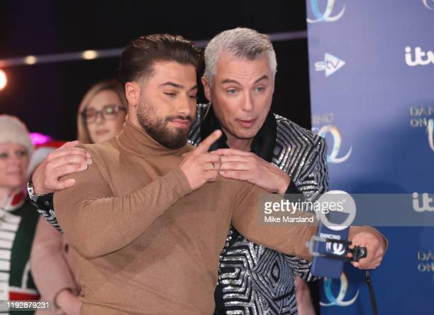 Kemal Cetinay and John Barrowman during the Dancing On Ice 2019 photocall at ITV Studios on December 09 2019 in London England