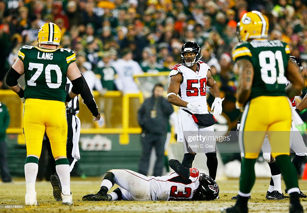 Kemal Ishmael #36 of the Atlanta Falcons lies on the field after being injured in the third quarter against the Green Bay Packers at Lambeau Field on December 8, 2014 in Green Bay, Wisconsin.