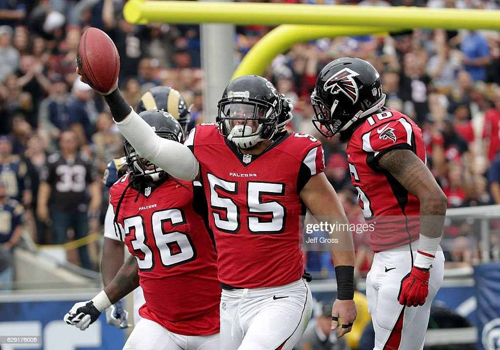 Kemal Ishmael #36, Paul Worrilow #55 and Justin Hardy #16 of the Atlanta Falcons celebrate Worrilow's fumble recovery on the opening kick off in the first quarter at Los Angeles Memorial Coliseum on December 11, 2016 in Los Angeles, California.