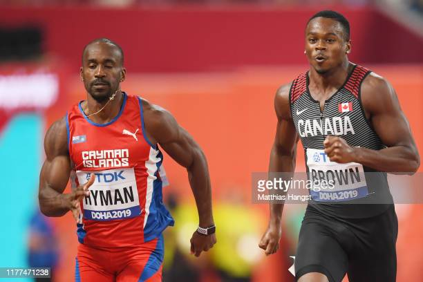 Kemar Hyman of Cayman Islands and Aaron Brown of Canada compete in the Men's 100 metres heats during day one of 17th IAAF World Athletics...