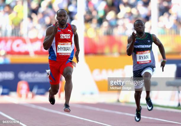 Kemar Hyman of the Cayman Islands and Lester Ryan compete in the Men's 100 metres heats on day four of the Gold Coast 2018 Commonwealth Games at...