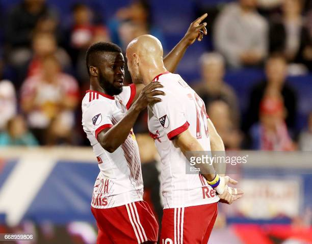 Kemar Lawrence and Aurelien Collin of New York Red Bulls talk before a kick in the second half against the DC United at Red Bull Arena on April 15...