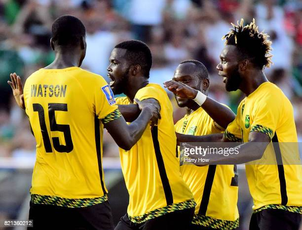 Kemar Lawrence of Jamaica celebrates his goal with JeVaughn Watson Michael Binns and Owayne Gordon to take a 10 lead over Mexico during the CONCACAF...