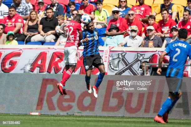 Kemar Lawrence of New York Red Bulls and Chris Duvall of Montreal Impact challenge for the ball during the New York Red Bulls Vs Montreal Impact MLS...