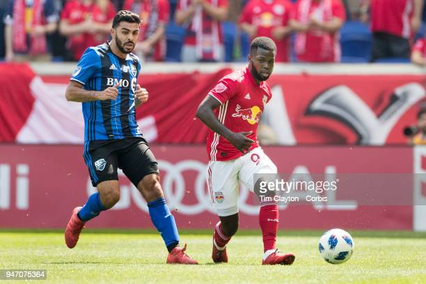 Kemar Lawrence of New York Red Bulls challenged by Victor Cabrera of Montreal Impact during the New York Red Bulls Vs Montreal Impact MLS regular...