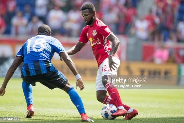 Kemar Lawrence of New York Red Bulls defended by Chris Duvall of Montreal Impact during the New York Red Bulls Vs Montreal Impact MLS regular season...