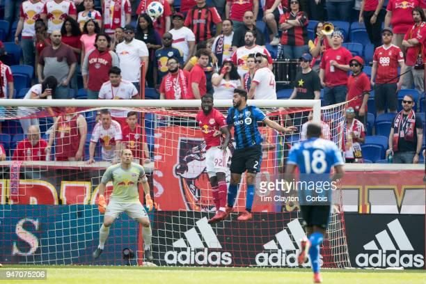 Kemar Lawrence of New York Red Bulls heads clear while challenged by Victor Cabrera of Montreal Impact during the New York Red Bulls Vs Montreal...