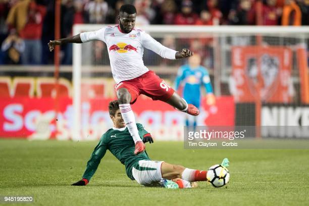 Kemar Lawrence of New York Red Bulls is challenged by Isaac Brizuela of CD Guadalajara during the New York Red Bulls Vs CD Guadalajara CONCACAF...