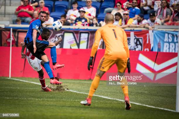 Kemar Lawrence of New York Red Bulls takes the shot on goal during the Major League Soccer match between Montreal Impact and New York Red Bulls at...