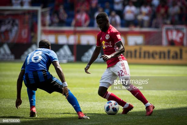 Kemar Lawrence of New York Red Bulls tries to put a move past Chris Duvall of Montreal Impact during the Major League Soccer match between Montreal...